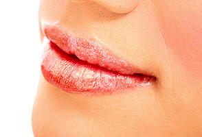 beautiful female lips with lipstick over a white background