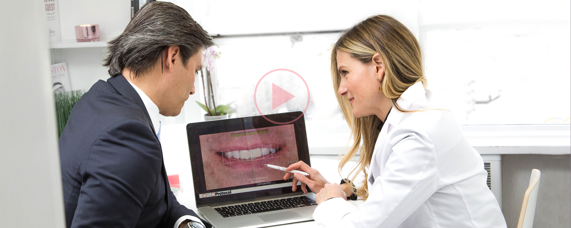 Dr Maria Cardenas with her patient at a laptop talking to him about his smile design with DSD dental treatment.